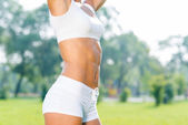 Sport woman in sunny park — Stock Photo