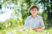 Boy in summer park — Stock Photo
