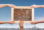 Hands holding frame — Stock Photo