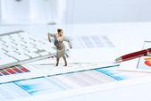 Businesswoman puppet doll on desk — Stock Photo