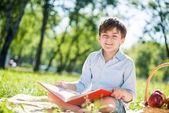 Boy in summer park — Stock Photo