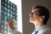 Male doctor looking at the x-ray image — Stock Photo