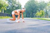 Woman runner in start pose — Stock Photo