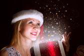 Woman opens a box of magic — Stock Photo
