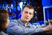 Young man at the bar — Stock Photo