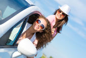 Women got out of the car window — Stock Photo