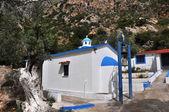 White greek chapel on samos island — Stock Photo
