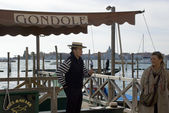 Venetian Gondoliere at his pier — Stock Photo