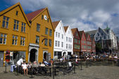 People in a cafe at Bryggen, the landmark of Bergen - Norway — Stock Photo