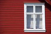 Facade of a classical red scandinavian wooden house — Stock Photo