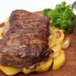 Beef steak with grainy mustard sauce — Stock Photo