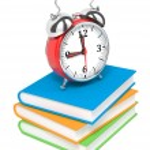 Alarm Clock on Pile of Books. — Stock Photo #13366139