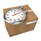 Stopwatch Over a Carton Boxes. — Stock Photo