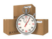 Stopwatch Over a Carton Boxes. — Stockfoto