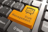 Teclado con botón de gestión de riesgo. — Foto de Stock