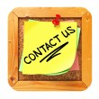 Contact Us. Yellow Sticker on Bulletin. — Stock Photo #30442093