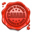 Stock Photo: Made in Canad- Stamp on Red Wax Seal.