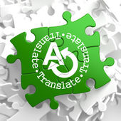 Translating Concept on Green Puzzle Pieces. — 图库照片