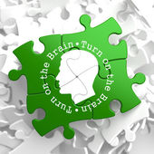 Turn On the Brain: Green Puzzle Pieces. — Stock Photo