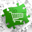 Shopping Cart Icon on Green Puzzle. — Stock Photo