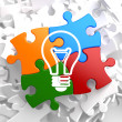 Light Bulb Icon on Multicolor Puzzle. — Stock Photo