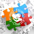 Charity Concept on Multicolor Puzzle. — Stock Photo