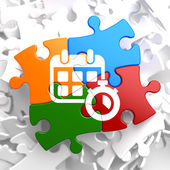 Calendar with Timer Icon on Multicolor Puzzle. — Stock Photo