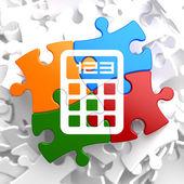 Calculator Icon on Multicolor Puzzle. — Stock Photo