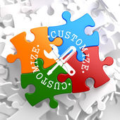 Customize Concept on Multicolor Puzzle. — Stock Photo