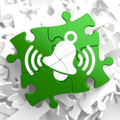 Ringing White Bell Icon on Green Puzzle. — Stock Photo