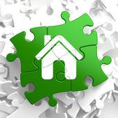 Home Icon on Green Puzzle. — Foto de Stock