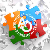 Translating Concept on Multicolor Puzzle. — Foto de Stock