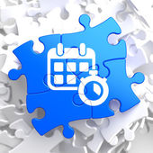 Calendar with Timer Icon on Blue Puzzle. — Stock Photo