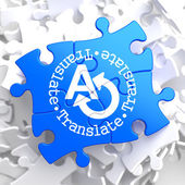 Translating Concept on Blue Puzzle. — Stock Photo