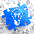 Light Bulb Icon on Blue Puzzle. — Stock Photo