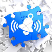 Ringing White Bell Icon on Blue Puzzle. — Stock Photo