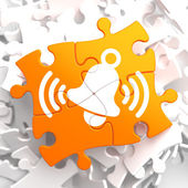 Ringing White Bell Icon on Orange Puzzle. — Stock fotografie
