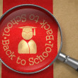 Magnifying Glass with Back to School Icon. — Stock Photo