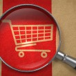 Magnifying Glass with Shopping Cart Icon. — Foto Stock