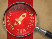 Magnifying Glass with Web Traffic Concept. — Stock Photo