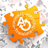 Translating Concept on Orange Puzzle. — Foto de Stock