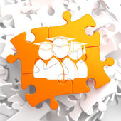 Group of Graduates Icon on Orange Puzzle. — Stock Photo
