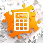 Calculator Icon on Orange Puzzle. — Stock Photo