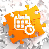Calendar with Timer Icon on Orange Puzzle. — Stock Photo