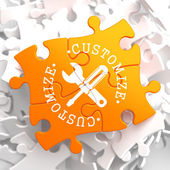 Customize Concept on Orange Puzzle. — Stock Photo