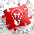 Light Bulb Icon on Red Puzzle. — Stock Photo