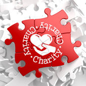 Charity Concept on Red Puzzle. — Stock Photo