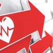 Stock Photo: Icon of Heart with Cardiogram Line on Red Arrow.
