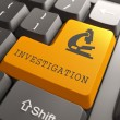Keyboard with Investigation Orange Button. — Stock Photo #35515451
