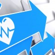 Stock Photo: Icon of Heart with Cardiogram Line on Blue Arrow.